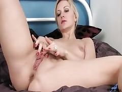 Beast heavy nipple milf rubs the brush pussy coupled with fucks a heavy dildo